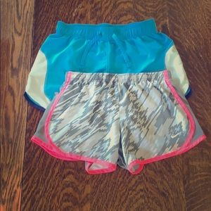Two pairs of girls athletic shorts.